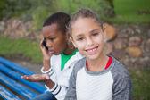 Little girl and friend talks on phone — Stok fotoğraf