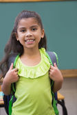 Cute pupil smiling in classroom — Stock Photo