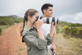 Couple taking picture on mountain terrain — Stock Photo