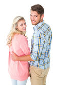 Attractive couple turning and smiling at camera — Stock Photo