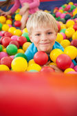 Boy playing in ball pool — Stock Photo