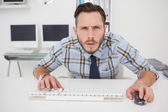 Focused casual businessman working at his desk — Stock Photo