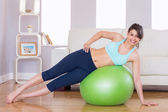 Fit brunette in plank position on exercise ball  — Stock Photo
