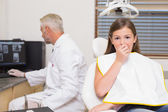Terrified little girl in dentists chair — Stock Photo
