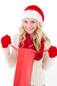 Festive blonde holding shopping bag — Stock Photo