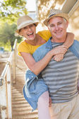 Happy mature couple having fun in the city — Stock Photo