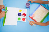 Little boys painting at table in classroom — Stock Photo