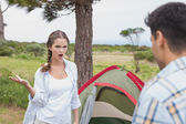 Couple with tent on countryside landscape — Stock Photo