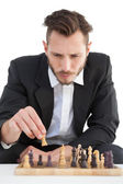 Focused businessman playing chess solo — Stock Photo