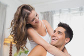 Loving happy couple together at home — Stock Photo