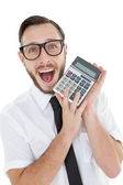 Nerdy excited businessman showing calculator — Стоковое фото