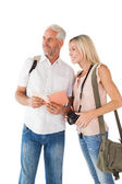 Happy tourist couple using the guidebook — Stockfoto