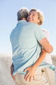 Senior woman hugging her partner — Stock Photo