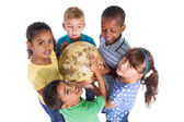 Cute schoolchildren holding globe — Stock Photo