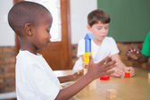 Pupils playing with building blocks — Stock Photo