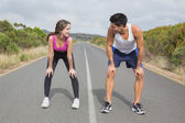 Couple running on the open road together — Stock Photo