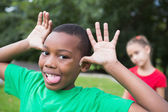 Little boy making silly faces outside — Stock Photo