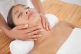 Beautiful brunette enjoying head massage — Stock Photo
