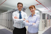 Confident data technicians looking at camera — Stock Photo
