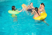 People playing in the swimming pool — Stock Photo