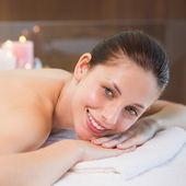 Beautiful woman lying on massage table at spa center — Stock Photo