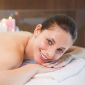 Beautiful woman lying on massage table at spa center — Stock Photo