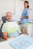 Patient smiling sitting in the chair — 图库照片