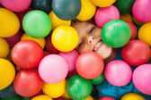 Happy boy playing in ball pool  — Stock Photo