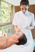 Attractive woman receiving treatment at spa center — Stock Photo