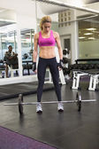 Full length of a fit woman in gym — Foto de Stock