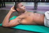 Man doing abdominal crunches in gym — Stock Photo