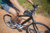 Athletic young man mountain biking — Foto Stock