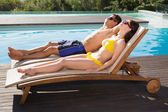 Couple resting on sun loungers — Photo