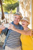 Happy mature couple taking a selfie together in the city — Stock Photo