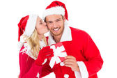 Festive young couple exchanging presents — Stock Photo