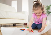 Girl drawing in the living room — Foto Stock
