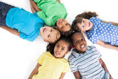 Children lying in a circle — Stock Photo
