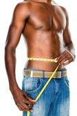 Fit man measuring waist — Stok fotoğraf