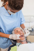 Dentist examining a patients teeth — Stock Photo