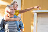 Happy mature couple having fun in the city — Stockfoto
