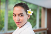 Portrait of a beautiful young woman in bathrobe — Stock Photo