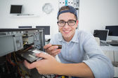 Smiling computer engineer working — Stock Photo