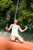 Pretty tennis player celebrating a win — Stock Photo