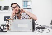 Annoyed computer engineer making a call — Stock Photo