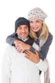 Happy couple in winter fashion embracing — Stock Photo