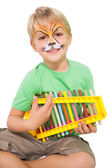 Boy playing xylophone — Stock Photo