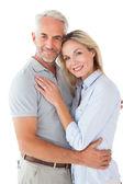 对幸福的夫妇站和相机微笑 — 图库照片