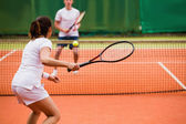 Tennis players playing a match on the court — Stock Photo