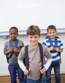 Classmates smiling together in classroom — Stock Photo