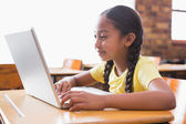 Pupil looking at laptop in classroom — Stock Photo